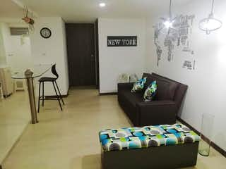 Una sala de estar llena de muebles y una ventana en Apartamento en Venta HOLANDA