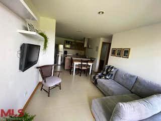 Una sala de estar llena de muebles y una televisión de pantalla plana en Pietra Santa (San Antonio de Pereira)