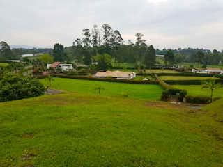 Un campo verde con un tren que lo atraviesa en Lote en venta en San Antonio De Pereira de 2562m²