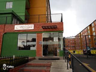 Una señal que está en el lado de un edificio en Apartamento En Venta En Bogota Tintalá