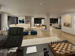 Una sala de estar llena de muebles y una chimenea en Cenit de la Cabrera