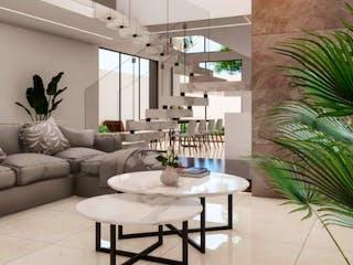 Una sala de estar llena de muebles y una planta en maceta en Residencial Cipres