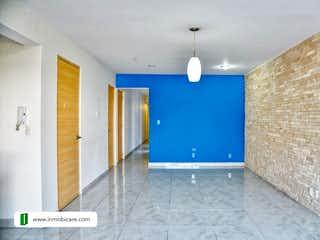 Un baño azul y blanco con paredes azules en Departamento en venta Río Támesis Cuauhtemoc CDMX