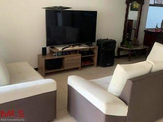 Una sala de estar llena de muebles y una televisión de pantalla plana en Boreal