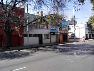 Una calle de la ciudad llena de edificios y árboles en Casa en venta en Clavería 318m²