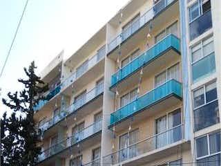 Un edificio alto sentado al lado de una calle en Departamento en venta en Santa Cruz Atoyac con acceso a Gimnasio