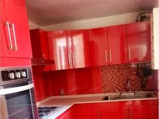 Una foto de una cocina con un contador rojo en Departamento en Venta en Del Valle Centro Benito Juárez
