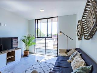Una sala de estar llena de muebles y una televisión de pantalla plana en CUBO 282