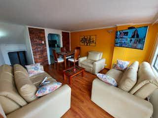 Una sala de estar llena de muebles y una televisión de pantalla plana en VENTA DUPLEX CEDRITOS (USAQUEN)