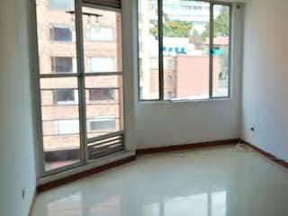Una vista de un pasillo con una puerta abierta en Apartamento en venta en Marly de 1 hab.