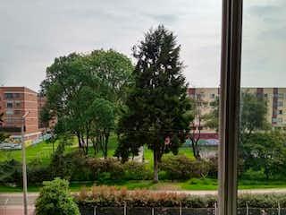 Una vista de una ciudad desde una ventana en Apartamento En Venta En Bogota Castilla
