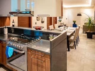 Una cocina con una estufa y un fregadero en Departamento en Venta Col. Del Valle, Excelente ubicación