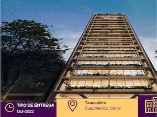 Un edificio alto con un reloj en la parte superior en Departamento en venta en Tabacalera, 44m²
