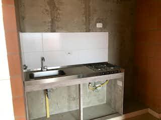 Una estufa encima del horno sentado dentro de la cocina en Apartamento en venta en La Balsa de 59m²