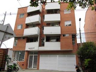Un gran edificio de ladrillo con un montón de ventanas en Apartamento en venta en Santa Mónica 30m²
