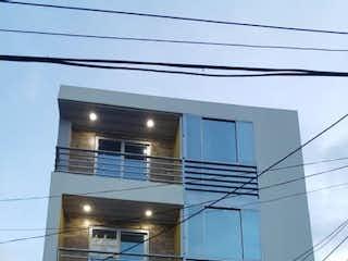 Un cierre de un edificio con una ventana en Apartamento en venta en Barrio Kennedy de 54m² con Balcón...