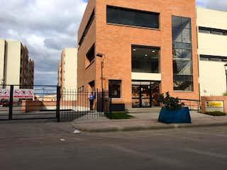 Un edificio de ladrillo con un reloj en el lado en Venta - Apartamento - Mosquera