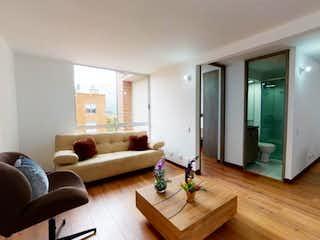 Una sala de estar llena de muebles y un suelo de madera en Apartamento En Venta En Bogota Suba