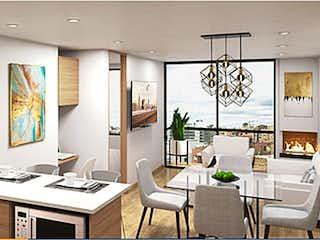 Una cocina con una mesa y una mesa en Luminium