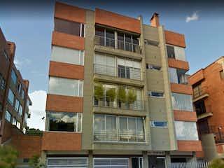 Un edificio alto con muchas ventanas en Apartamento en Venta en La Calleja Baja Bogotá