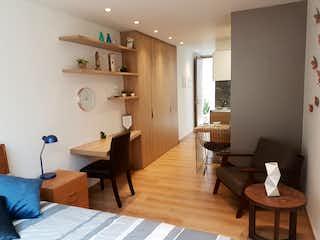 Una sala de estar llena de muebles y una mesa en Apartamento loft en venta en chapinero