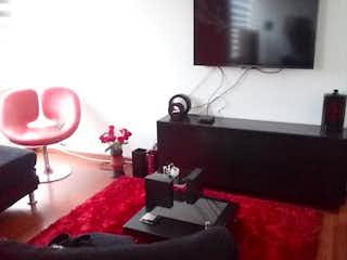 Una sala de estar llena de muebles y una televisión de pantalla plana en Apartamento en Venta GRAN GRANADA