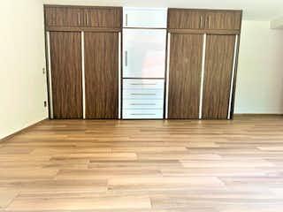 Una puerta de madera en medio de una habitación en Casa en venta en Santa Cruz Atoyac 80m²