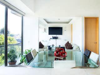 Una sala de estar llena de muebles y una ventana en DEPARTAMENTO EN VENTA JARDíN BALBUENA