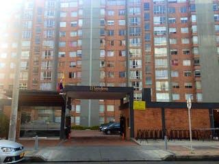 Un edificio alto sentado al lado de una calle en Apartamento En Arriendo/venta En Bogota La Felicidad