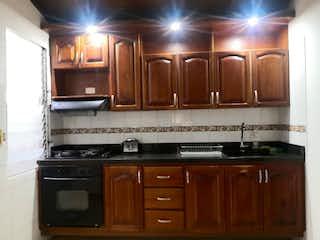 Una cocina con una estufa y un fregadero en Venta de Apartamento en Alcalá Envigado P.H.