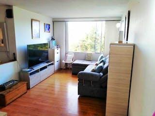 Una sala de estar llena de muebles y una televisión de pantalla plana en Apartamento en venta en Capellania de 63m²
