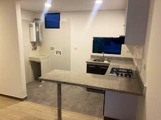 Un cuarto de baño con lavabo y un espejo en Apartamento En Venta En Bogota Fontibon