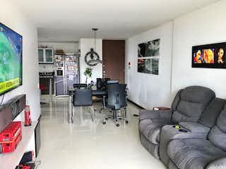 Una sala de estar llena de muebles y una televisión de pantalla plana en Apartamento en Venta LAS PALMAS