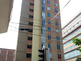 Un semáforo sentado al lado de una calle en Apartamento en Venta BUENOS AIRES