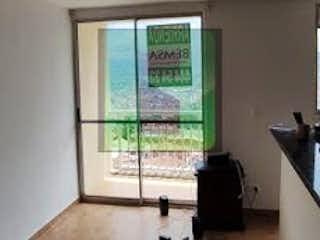 Una sala de estar con un sofá una silla y un televisor en Apartamento en Venta MIRADOR