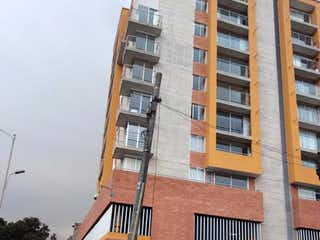 Un edificio alto sentado en la esquina de una calle en Apartamento En Venta En Bogota Veraguas