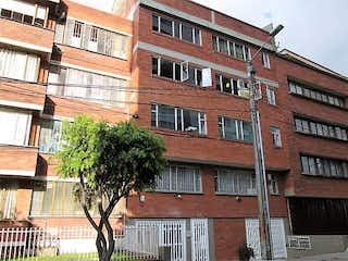 Un edificio de ladrillo rojo con un edificio de ladrillo rojo en Apartamento En Venta En Bogota Quinta Paredes