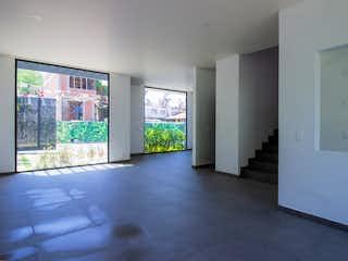 Una vista de una sala de estar y comedor en Spazio Mirador Tepepan