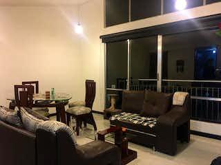 Una sala de estar llena de muebles y una televisión de pantalla plana en Apartamento En Venta En Bogota Tibabita-Usaquén