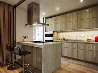 Una cocina con una mesa y sillas en ella en Refugio de Piedra