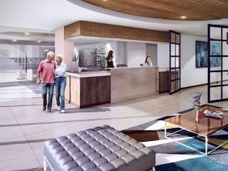 Un grupo de personas sentadas en una sala de estar en 103 Senior Living Aptos