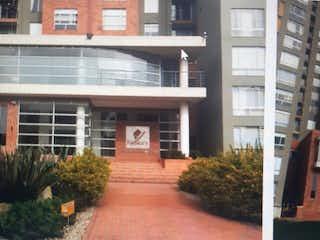 Un gran edificio con un gran ventanal en él en VENTA APARTAMENTO CL 169