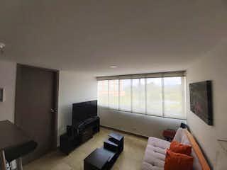 Una sala de estar llena de muebles y una televisión de pantalla plana en Apartamento en venta en El Porvenir de 57m²