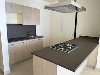 Una cocina con una estufa y un refrigerador en DEPARTAMENTO EN VENTA CARSO / VISTAS DEL BOSQUE