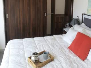 Un dormitorio con una cama y una cama en Último Depto excelente acabados Amenidades 5 Estrellas