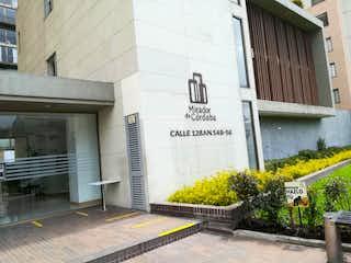 Un edificio con una señal en el costado en Apartamento En Venta En Bogota Prado