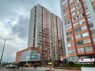 Un edificio alto sentado al lado de un edificio alto en Apartamento En Venta En Bogota Tabaku