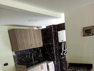 Una cocina con un fregadero y una estufa en Apartamento Venta Plaza Navarra, Bello