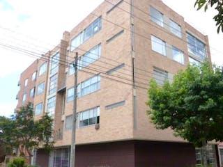 Un edificio de ladrillo alto con un reloj en él en Apartamento en venta en Contador, 74m²