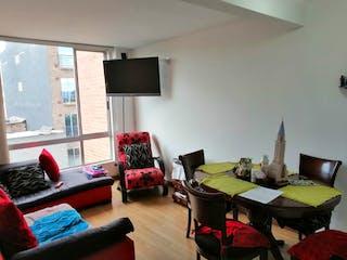 Una sala de estar llena de muebles y una televisión de pantalla plana en Conjunto Residencial Pentagrama
